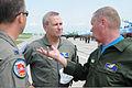 Maj. Gen. Don Ralph, center, and Maj. Gen. Vasyl Nikiforov, right, discuss their upcoming flight at Mirgorod Air Base, Ukraine, July 22, 2011, during Safe Skies 2011 110722-Z-ZZ999-274.jpg
