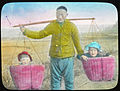 Man carrying two young children in the baskets of a yoke, China, ca.1917-1923 (IMP-YDS-RG224-OV1-0000-0030).jpg