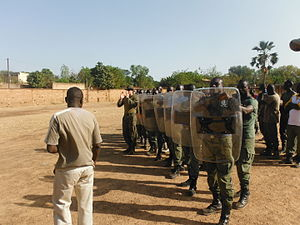 Law enforcement in Burkina Faso - The Gendarmerie as a paramilitary force: Burkinabe Gendarmes undergoing crowd-control training delivered by US Marines in 2013.