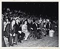 Mary Collins and Mayor John F. Collins sit in front of a crowd of people in Fenway Park (12305572245).jpg