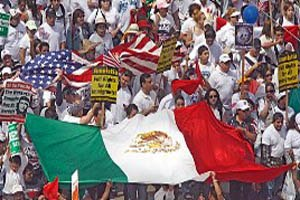 Great American Boycott - Marchers in Los Angeles carrying a Mexican and American flag
