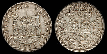 A silver coin depicting pillars, a globe and a coat of arms