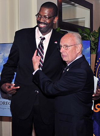 Bill Schonely - Schonely with former Trail Blazer Mike Harper at a 2013 benefit event