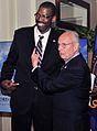 Michael Harper with Bill Schonely in 2013.jpg