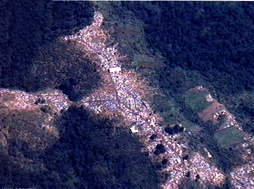 Aerial photograph of a Mihanda, Zaire refugee camp in 1996. Pictured are 500+ tents set up in the Mitumba Mountains. Mihanda camp.jpg