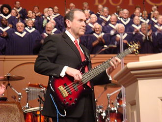 Mike Huckabee - Huckabee playing bass guitar at Thomas Road Baptist Church in 2008