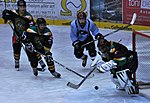 Military hockey teams skate at European tournament 140221-D-SK857-081.jpg