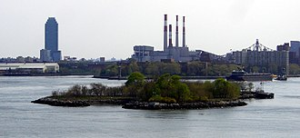 Mill Rock - Mill Rock as seen from Wards Island Bridge. The Citicorp Building and Big Allis are visible in the background.