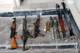 Small arms - The three weapons on the left are small arms, while the two on the right are light weapons, captured in Fallujah, Iraq by the U.S. Marine Corps in 2004.