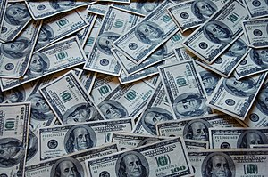 English: Many dollar banknotes.