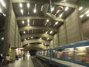 Transportation in Montreal - Metro train departing Montreal's Place-Saint-Henri Metro Station.