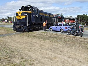 Mornington Railway - A diesel locomotive crosses Moorooduc Highway in February 2007