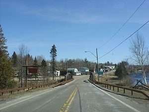 New York State Route 458 - NY 458 eastbound entering the hamlet of St. Regis Falls