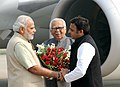 Narendra Modi being received by the Governor of Uttar Pradesh, Shri Ram Naik and the Chief Minister of Uttar Pradesh, Shri Akhilesh Yadav, on his arrival at Varanasi airport, Uttar Pradesh on November 07, 2014.jpg