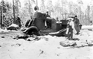 Battle of Tolvajärvi - Destroyed Soviet armoured car is inspected by Finnish officers. SA-kuvat