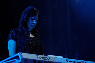 Gillian Gilbert - Gilbert on stage with New Order at Fête de l'Humanité in 2012