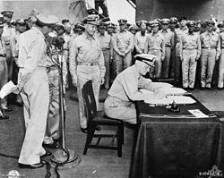 Admiral Nimitz signs surrender