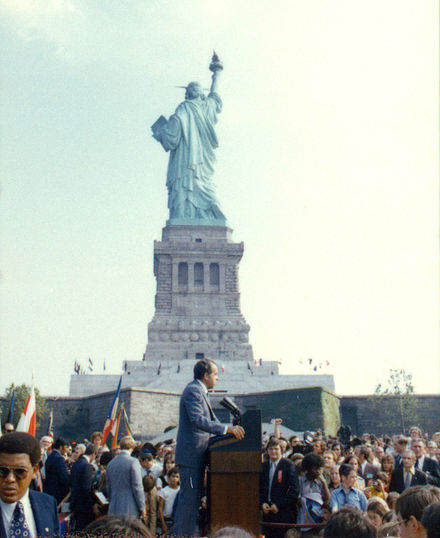 September 26, 1972: President Richard Nixon visits the statue to open the American Museum of Immigration. The statue's raised right foot is visible, showing that it is depicted moving forward. Nixon at Liberty Island.jpg