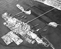 20 September 1943, Oklahoma fully righted, prior to refloating.