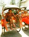 Old riksja rider in Indonesia.jpg
