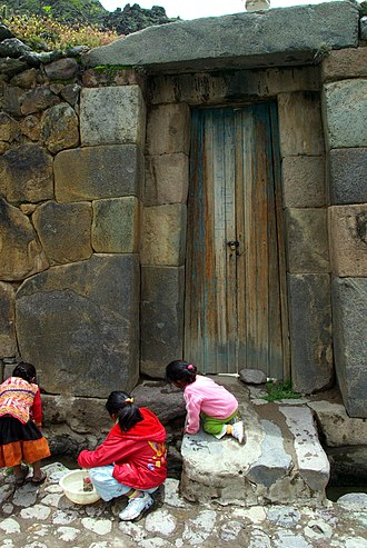 Ollantaytambo - A typical Inca doorway still used in the town:  The single stone lintel is a sign of importance.