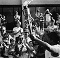Olympic Torch being carried in front of crowd at University of Texas at Arlington's Hereford Student Center (10010571).jpg