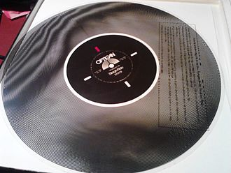 Optical sound - A transparent program disc imprinted with concentric optical sound tracks, used for the Optigan musical organ