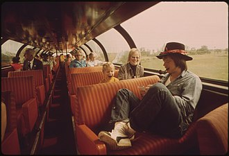 Great Dome (railcar) - Image: PASSENGERS RELAX AND VIEW THE SCENERY FROM THE LOUNGE CAR OF THE EMPIRE BUILDER ENROUTE FROM CHICAGO TO EAST GLACIER... NARA 556080