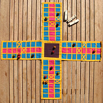 Pachisi - A game of Pachisi on a cloth board