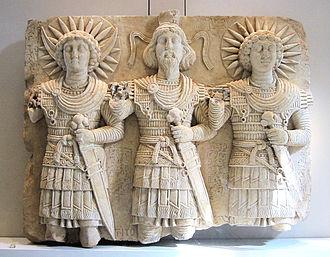 Malakbel - Palmyrene deities: from left to right: the lunar god Aglibôl, the supreme god Beelshamên, the sun god Malakbêl.  1st century CE slab, found near Bir Wereb, Wadi Miyah, Syria, Louvre Museum.