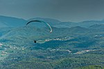 Paraglider in the air (30821811848).jpg