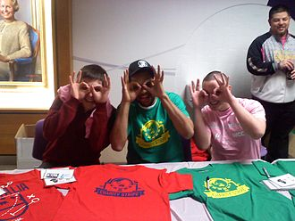"Patty Mills - Mills (center) strikes a ""3 Goggles"" pose with two fans in 2011"