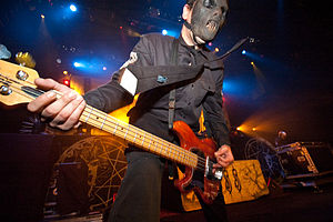 Bass guitarist Paul Gray performing in metal b...