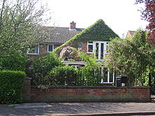 Larkin lived in a comfortable residential area in Hull at No.105, Newland Park in a detached house of red brick construction. Doors on the first floor at the front of the house open onto a small balcony. As seen in 2008 part of the walls at the front of the house are covered with a green climbing plant, but a round commemorative plaque is visible