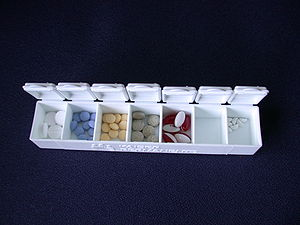 English: A pill box with various medications i...