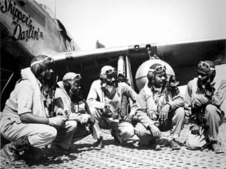 """332d Expeditionary Operations Group - Pilots of the 332d Fighter Group, """"Tuskegee Airmen,"""" the elite, all-African American 332d Fighter Group at Ramitelli Airfield, Italy. From left to right, Lt. Dempsey W. Morgran, Lt. Carroll S. Woods, Lt. Robert H. Nelron, Jr., Capt. Andrew D. Turner, and Lt. Clarence P. Lester."""