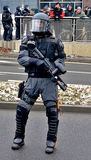 Pepper-spray projectile - German policeman with Pepperball gun in Dresden