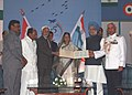 Pratibha Devisingh Patil, the Vice President, Mohd. Hamid Ansari and Prime Minister, Dr. Manmohan Singh releasing a special stamp on the occasion of IAF's Platinum Jubilee Celebrations, in New Delhi on October 08, 2007.jpg