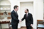 President George H. W. Bush greets Lee Greenwood in the Oval Office.jpg