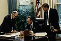 President George H. W. Bush reads a document as General Brent Scowcroft makes notations and Vice President Dan Quayle looks on.jpg