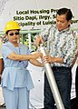 President Gloria Macapagal-Arroyo, with Noli De Castro, leads the lowering of time capsule.jpg
