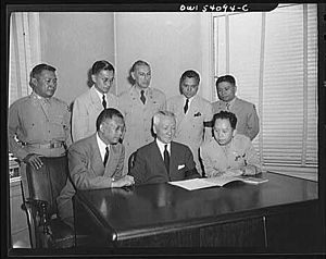 Sergio Osmeña - President Osmeña with members of his cabinet. Front row; left to right: Jaime Hernandez, Secretary of Finance; President Osmeña; Col. Carlos P. Romulo, Resident Commissioner and Secretary of Information. Back row, left to right: Col. Mariano A. Erana, Judge Advocate General of the Philippine Army and Secretary of the Department of Justice, Labor, and Welfare; Dr. Arturo B. Rotor, Secretary of Agriculture and Commerce; Ismael Mathay, Budget and Finance Commissioner; Colonel Alejandro Melchor, Undersecretary of National Defense, representing General Basilio Valdes, Secretary of National Defense.