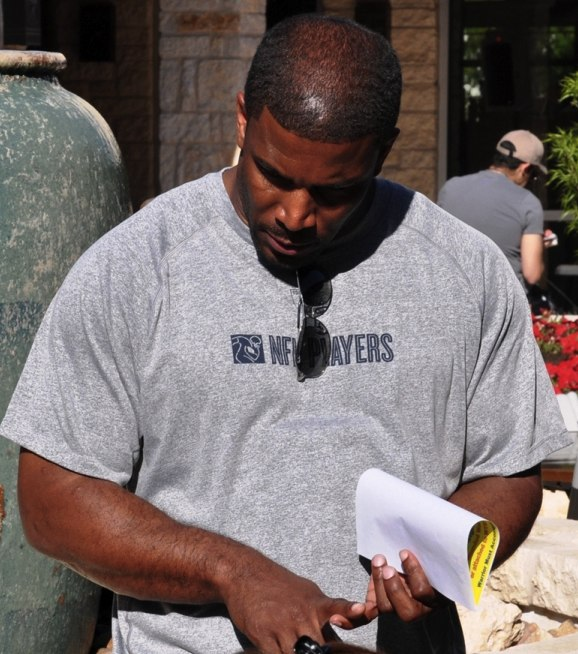 Priest Holmes speaks with soldiers CROPPED