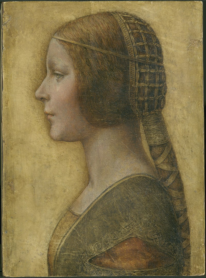A young woman in profile, looking to the left.