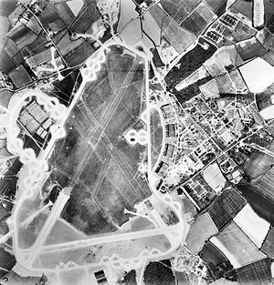 RAF Wattisham - 27 May 1944 Aerial photograph of RAF Wattisham the control tower and airfield code are in front of the four C-Type hangars on the right.