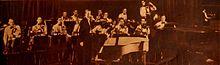 Ray Noble kaj lia orkestro - Radio Mirror, oktobro 1935.jpg