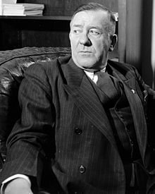 Black-and-White image of Raymond Springer wearing a suit.