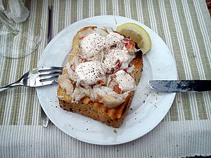 Crab meat - Crab meat from crab claws, atop toast