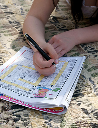 Crossword - Person solving a Finnish crossword puzzle.