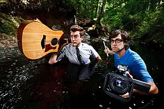 """Rhett and Link - Rhett (left) and Link (right) posing for their """"Up to This Point"""" album cover."""